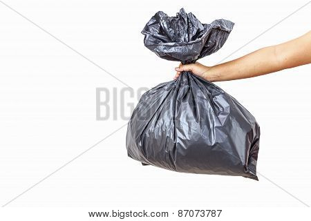 Hand Holding Garbage Bag