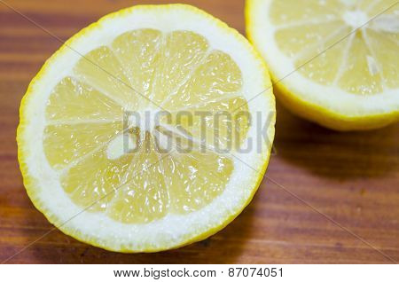 Sliced Lemon On A Wooden Table