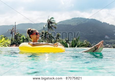 Woman Body Posing In Summer In Pool With Clear Water