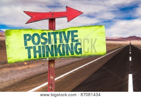 Positive Thinking sign with road background