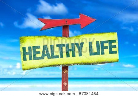 Healthy Life sign with beach background