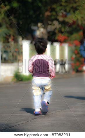 Blurry Young Boy Walk Away
