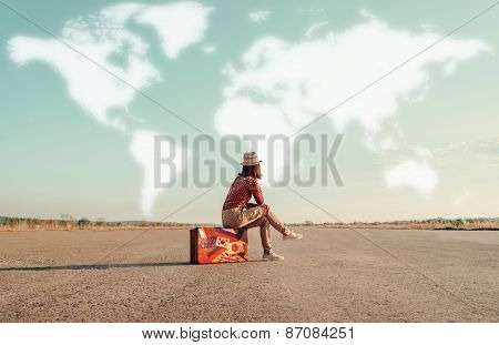 Traveler Girl Sitting On A Suitcase