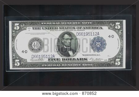 Five Dollar Bill Isolated on Black