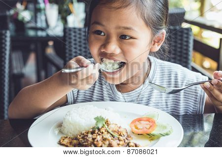 Thai Children Eating In Restaurant