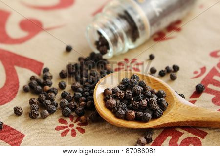 Black Pepper Seeds Spills Out Of Bottle