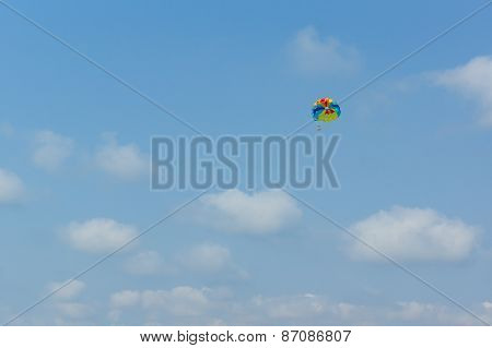 Parachute In The Sky Over The Sea