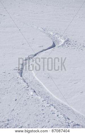 Tracks on a mountain Slope, extreme freeride in deep snow