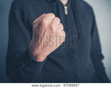 Young Man Raising His Fist