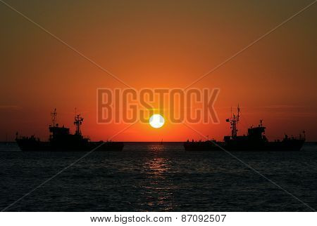 ships in the sea at sunset
