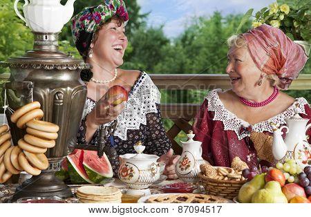Women Drinking Tea Outdoors