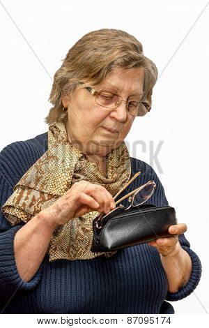 Old Woman In A Glasses Putting The Second Glasses Into A Spectacle Case