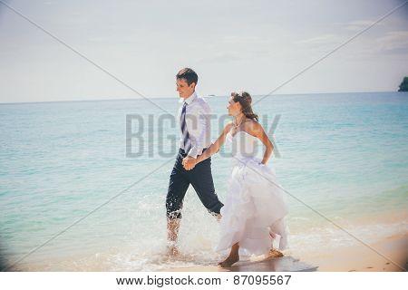 Bride And Groom Run Sandy Beach