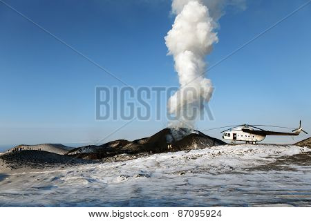 Helicopter And Tourists Near The Erupting Tolbachik Volcano On Kamchatka