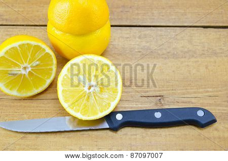 Halved Lemon And A Knife
