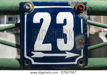 Weathered enameled plate number 23