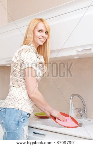 Mother and daughter wash dishes