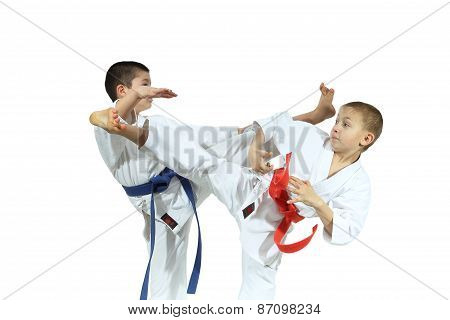 Two sportsman are training beat high kicks