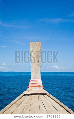 Thai boat bow with blue horizon