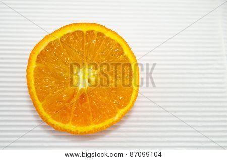 Halved Orange On A White Cardboard