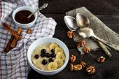 image of porridge  - Breakfast with porridge and berries on wooden table - JPG