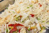 stock photo of chinese restaurant  - Closeup of chinese egg fried noodles meal on display at a hotel restaurant buffet - JPG