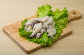 picture of cuttlefish  - Raw cuttlefish with herbs on the wood background - JPG