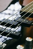 image of pick up  - black bass guitar close-up close-up string pick-up ** Note: Shallow depth of field - JPG