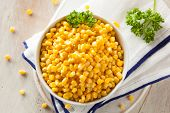 stock photo of steam  - Organic Yellow Steamed Corn in a Bowl - JPG