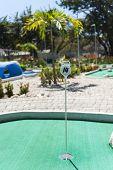 foto of miniature golf  - Hole 14 on a tropical outdoor mini golf course - JPG