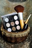 foto of face-powder  - cosmetics such as lipstick or powder applied to the face used to enhance or alter the appearance - JPG