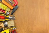 stock photo of workbench  - Workbench with different tools on wooden background - JPG