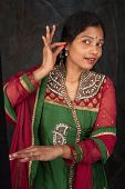 stock photo of indian sari  - Indian lady dancing traditional dance - JPG