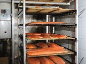 stock photo of smoke  - Smoked salmon fillet in a smoke oven - JPG