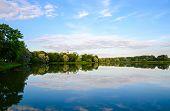 stock photo of yellow castle  - Nesvizh Castle on the banks of Castle pond Belarus - JPG