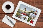 foto of paddling  - reviewing pictures of stand up paddling featuring a senior male on a digital tablet with a cup of coffee - JPG