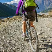 stock photo of biker  - Biker girl In Himalaya Mountains - JPG