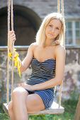 picture of swing  - young beautiful girl swinging on a swing - JPG