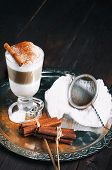 picture of latte  - Irish coffee cup filled latte poured layers on the metal tray - JPG