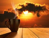 image of morning sunrise  - Morning cup of coffee with sunrise background - JPG