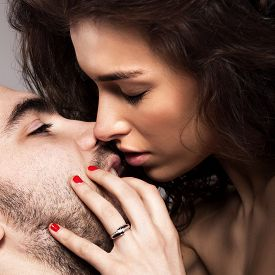 stock photo of hand kiss  - Romantic couple touching and kissing each other - JPG