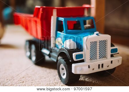 Colorful plastic toy truck on floor