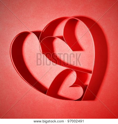 Red paper hearts - love or family concept. Shallow DOF!