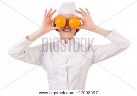 Pretty female doctor holding orange isolated on white