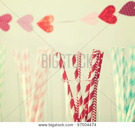 Colorful Paper Straws With A Garland Of Hearts
