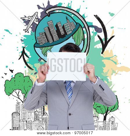 Businessman holding blank sign in front of his head against global tourism concept on paint splashes