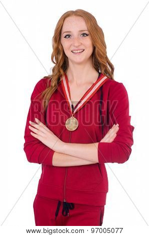 Pretty female sportsman with medal isolated on white