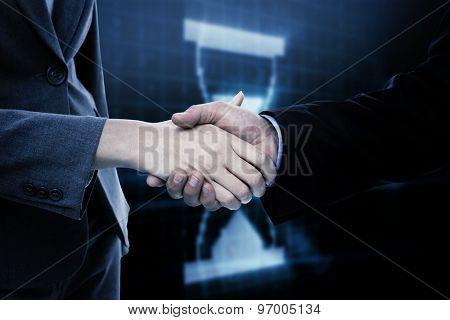 Close up of two businesspeople shaking their hands against digital timer