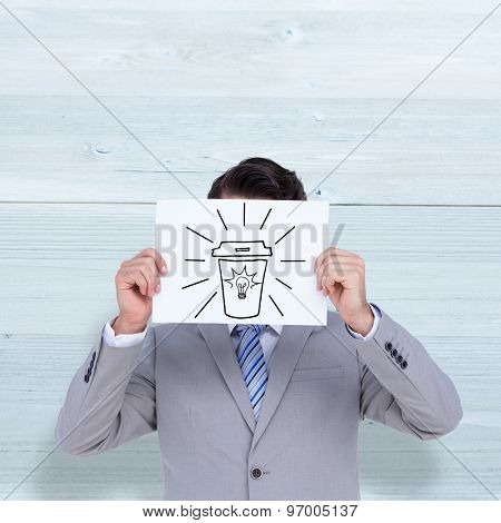 Businessman holding blank sign in front of his head against bleached wooden planks background