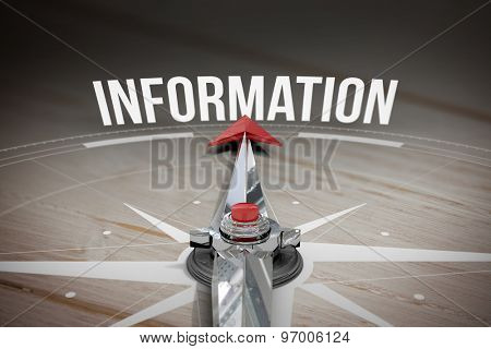 The word information and compass against brown wooden background